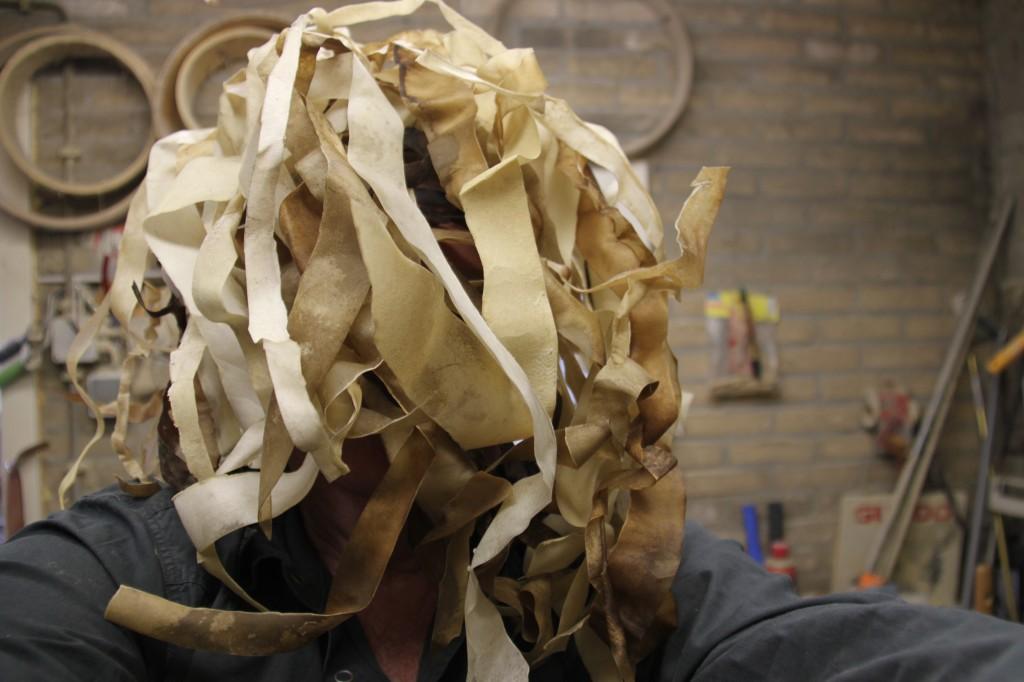 My head covered in bodhran skins.